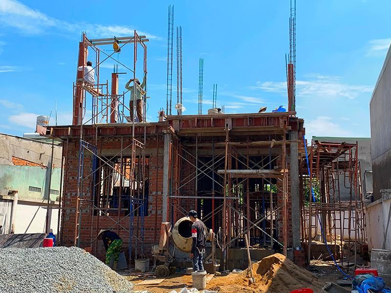 Nhà, đất đã thế chấp khi xây dựng có cần ngân hàng đồng ý?